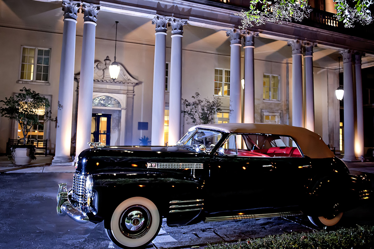 A vintage automobile reflects The Biltmore Ballrooms' classic elegance.