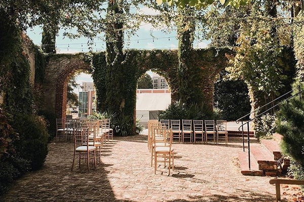 Ceremony in the courtyard. Photo by Vic Bonvicini Photography.